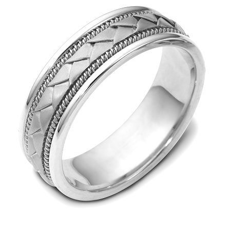 Item # 110021WE - 18 kt white gold hand made comfort fit Wedding Band 7.0 mm wide. The center of the band has a handcrafted braid with a handmade rope on each side of the braid. The center of the ring has a brush finish and the edges are polished. Different finishes may be selected or specified.