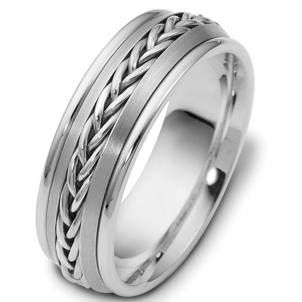 Item # 110221WE - 18 kt white gold, hand made comfort fit Wedding Band 7.0mm wide. The ring has a hand made braid in the center with a polished finish. The gold pieces on each side of the braid is a brush finish and the rest of the band is polished. Different finishes may be selected or specified.