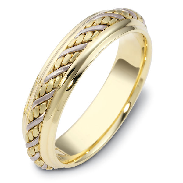 Item # 110241 - 14 kt two-tone hand made Wedding band 5.5 mm wide. The ring has a beautiful hand crafted braid in the center with a brush finish. The edges are polished. Different finishes may be selected or specified.