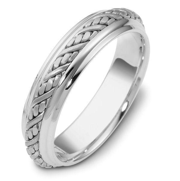 Item # 110241W - 14 kt white gold, hand made Wedding band 5.5 mm wide. The ring has a beautiful hand crafted braid in the center with a brush finish. The edges are polished. Different finishes may be selected or specified.