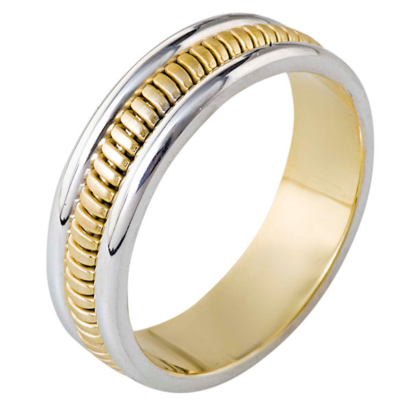 Item # 110281 - 14 kt two-tone hand made comfort fit Wedding Band 6.0 mm wide. The ring has a hand made pattern in the center that is a brush finish. The edges are polished. Different finishes may be selected or specified.