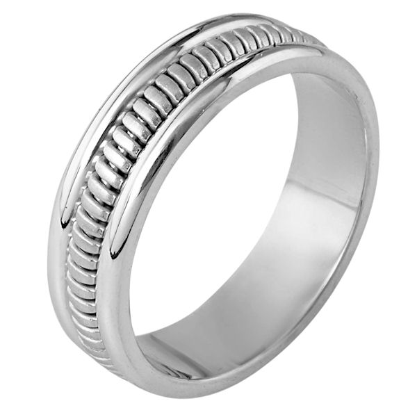 Item # 110281WE - 18 kt white gold, hand made comfort fit Wedding Band 6.0 mm wide. The ring has a hand made pattern in the center that is a brush finish. The edges are polished. Different finishes may be selected or specified.
