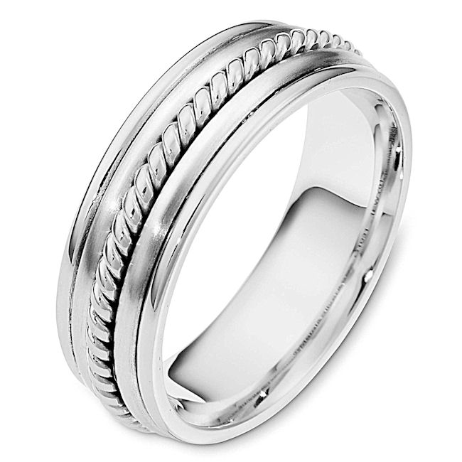 Item # 110311W - 14kt white gold, hand made comfort fit, 7.0 mm wide,approximately 2.4 mm thick wedding band. The ring has a hand made rope in the center which is a polished finish. The two pieces on each side of the rope are matte finish and the rest of the ring is polished. Different finishes may be selected or specified.