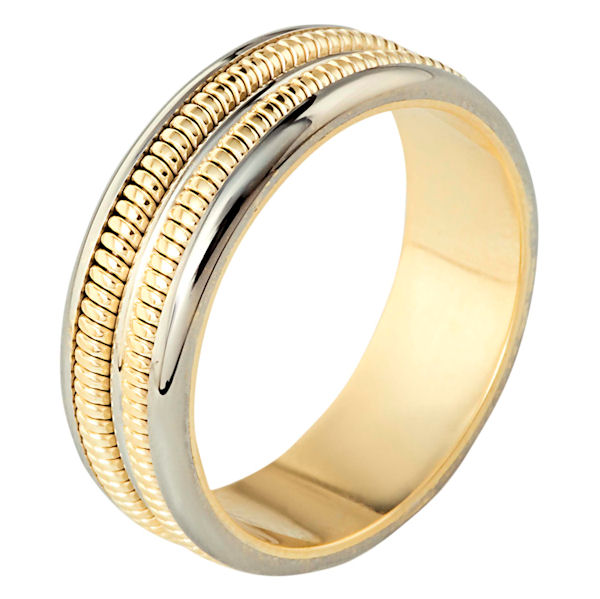 Item # 110351 - 14 kt two-tone hand made comfort fit, 7.0 mm wide wedding band. The ring has two hand made patterns in the band that have a brush finish. The edges are polished. Different finishes may be selected or specified.