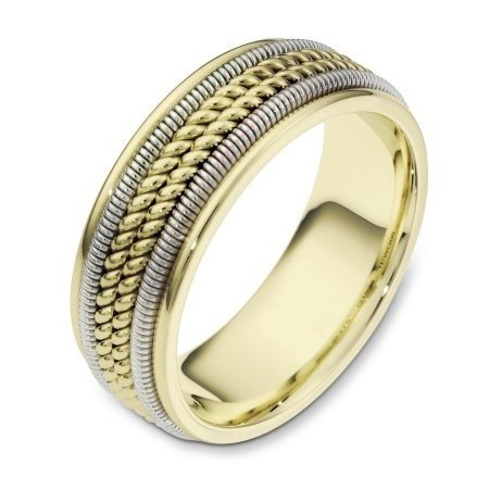 Item # 110361E - 18 kt two-tone hand made comfort fit, 8.0 mm wide wedding band. The ring has two different handmade patterns in the ring, a hand made rope and hand made spring designs. The ring has a polished finish. Different finishes may be selected or specified.