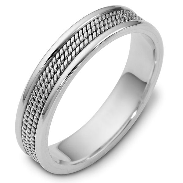 Item # 110431PP - Platinum hand made 5.0 mm wide wedding band. The ring has 3 hand made ropes in the center with a polished finish. The edges are polished. Different finishes may be selected or specified.