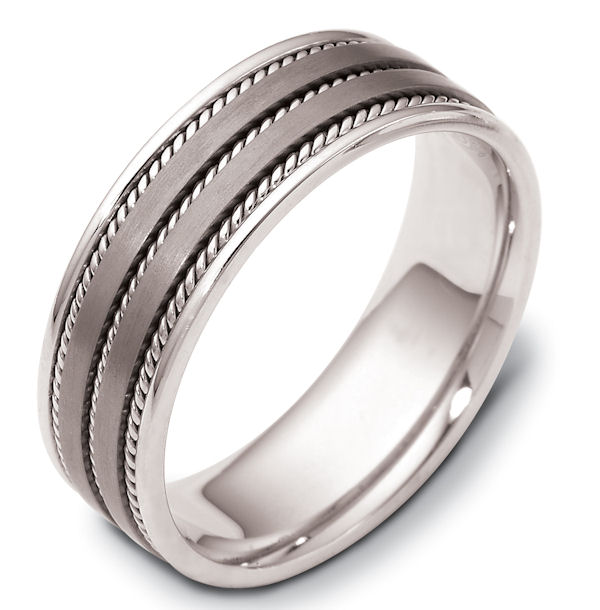 Item # 110531TG - 14 kt white gold and titanium , comfort fit, 7.0 mm wide wedding band. The ring has 3 handmade ropes inlayed in the ring. The two flat pieces in the center have a matte finish. The rest of the band has a polished finish. Different finishes may be selected or specified.