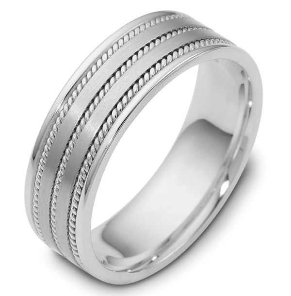 Item # 110531WE - 18 kt white gold, hand made comfort fit Wedding Band 7.0 mm wide. The ring has 3 handmade ropes inlayed in the ring. The two flat pieces in the center have a matte finish. The rest of the band has a polished finish. Different finishes may be selected or specified.