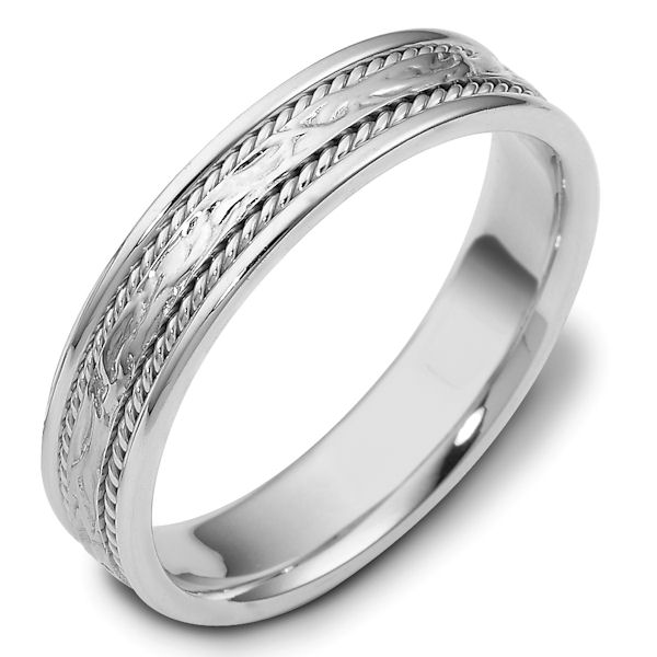 Item # 110561WE - 18 kt white gold, hand made comfort fit Wedding Band 5.0 mm wide. The ring has 2 handmade ropes on each side of the band. The center is patterned with a polished finish. Different finishes may be selected.