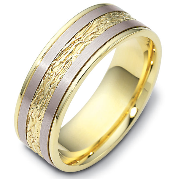 Item # 110601E - 18 kt two-tone hand made comfort fit Wedding Band 7.0 mm wide. The ring has a beautiful pattern in the center. The two pieces on each side of the patterned gold are matte finish. The rest of the band is polished. Different finishes may be selected or specified.