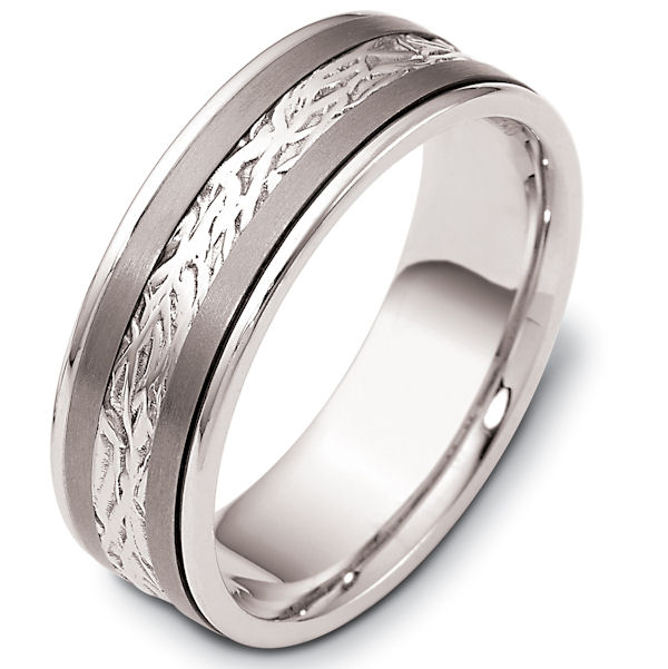 Item # 110601TG - 14 kt white gold and titanium , comfort fit, 7.0 mm wide wedding band. The ring has a beautiful pattern in the center. The two pieces on each side of the patterned gold are matte finish. The rest of the band is polished. Different finishes may be selected or specified.