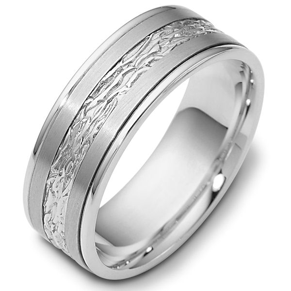 Item # 110601W - 14 kt white gold, hand made comfort fit Wedding Band 7.0 mm wide. The ring has a beautiful pattern in the center. The two pieces on each side of the patterned gold are matte finish. The rest of the band is polished. Different finishes may be selected or specified.