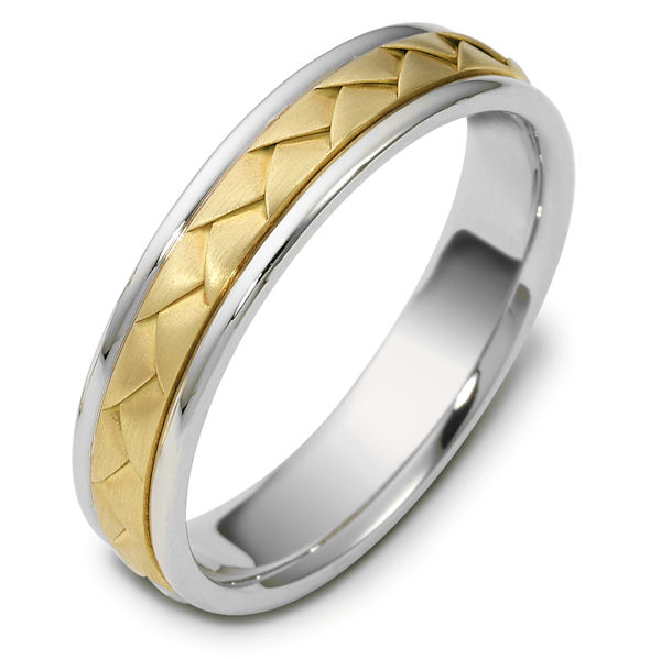 Item # 110751 - 14 kt hand made comfort fit Wedding Band 5.0 mm wide. The ring has a handmade braid in the center with a brush finish. The edges are polished. Different finishes may be selected or specified.