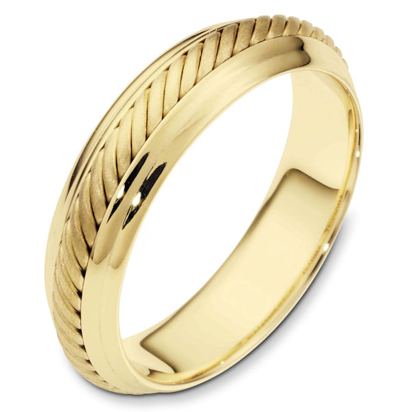Item # 110871 - 14 kt hand made comfort fit Wedding Band 5.5 mm wide. The ring has a hand made rope in the center with a brush finish. The edges are polished. Different finishes may be selected or specified.