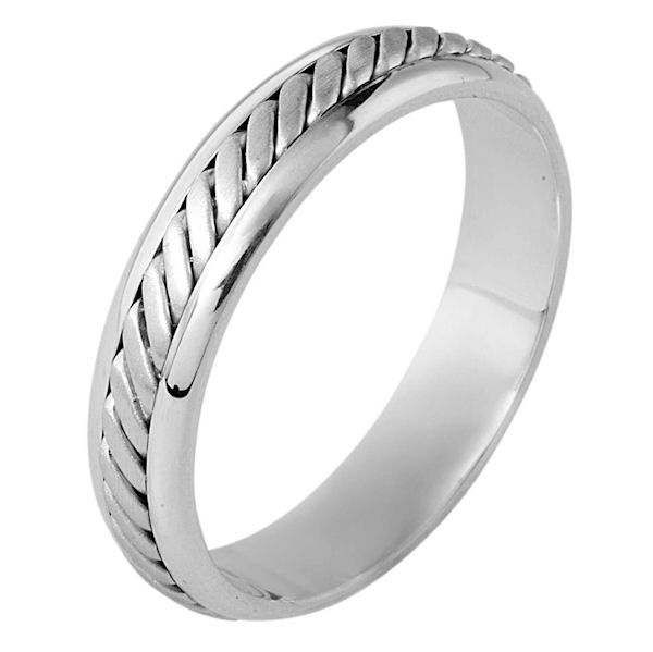 Item # 110881WE - 18kt white gold, hand made comfort fit Wedding Band 4.5 mm wide. The ring has a hand made pattern in the center with a brush finish. The edges are polished. Different finishes may be selected or specified.