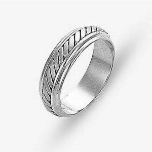 Item # 110891WE - 18 kt white gold, hand made comfort fit Wedding Band 5.5 mm wide. The ring has a hand made pattern in the center with a brush finish. The edges are polished. Different finishes may be selected or specified.
