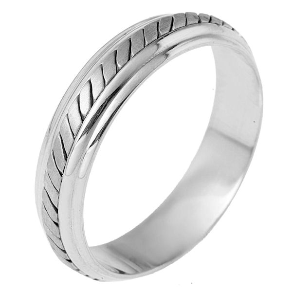 Item # 110901PP - Platinum hand made comfort fit Wedding Band 5.5 mm wide. The ring has a hand made pattern in the center with a brush finish. The edges are polished. Different finishes may be selected or specified.