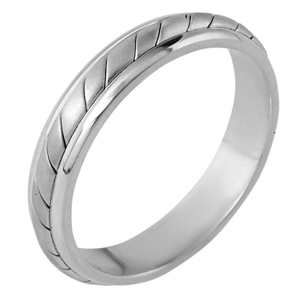 Item # 110921WE - 18 kt white gold, hand made comfort fit Wedding Band 4.5 mm wide. The ring has a hand made pattern in the center with a matte finish. The edges are polished. Different finishes may be selected or specified.