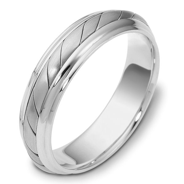 Item # 110951WE - 18 kt white gold, hand made comfort fit Wedding Band 5.0 mm wide. The ring has a hand made pattern in the center with a matte finish. The edges are polished. Different finishes may be selected or specified.
