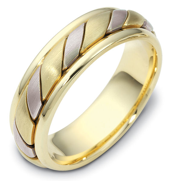 Item # 110961 - 14 kt two-tone hand made comfort fit Wedding Band 5.5 mm wide. The ring has a hand made pattern in the center with a brush finish. The edges are polished. Different finishes may be selected or specified.