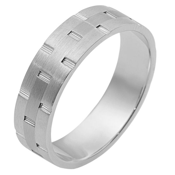 Item # 111131WE - 18 kt white gold, hand made comfort fit Wedding Band 6.0 mm wide. There are carved notches around the whole ring. The ring is a matte finish. Different finishes may be selected or specified.