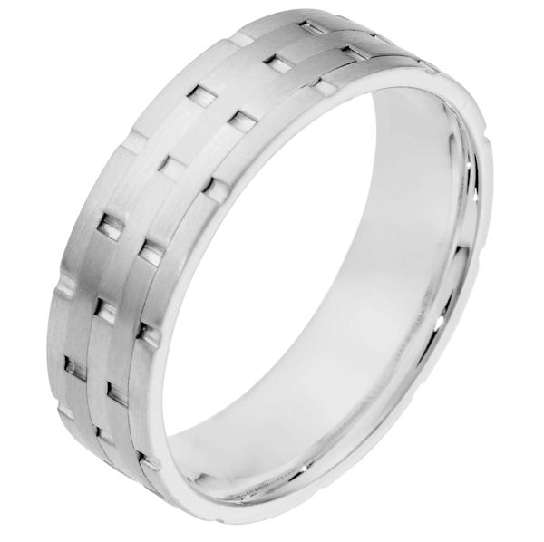 Item # 111141WE - 18 kt white gold, hand made comfort fit Wedding Band 6.5 mm wide. There are carved notches around the whole ring. The ring is a matte finish. Different finishes may be selected or specified.