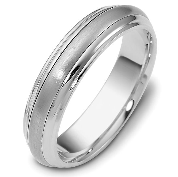 Item # 111291WE - 18kt White gold classic, comfort fit, 5.5mm wide wedding band. The ring has a matte finish in the center and the rest polished. Different finishes may be selected or specified.