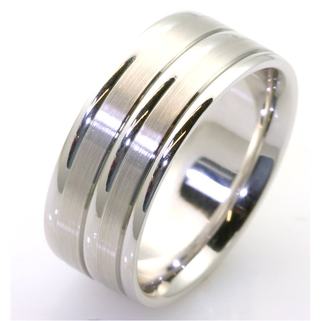 Item # 111531WE - 18 kt white gold, hand made comfort fit Wedding Band 8.5 mm wide. The two flat pieces in the band have a matte finish. The rest of the has a polished. Different finishes may be selected or specified.