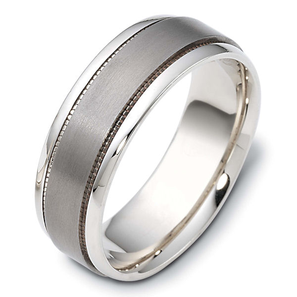 Item # 111621TG - 14 kt white gold and titanium, 7.5 mm wide, comfort fit wedding band. The titanium portion is a matte finish. On each side of the titanium piece is milgrain edges and the outer edges is polished. Different finishes may be selected or specified.