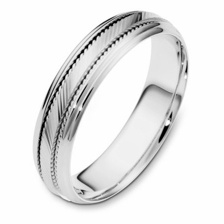 Item # 111631PP - Platinum hand made, wedding band 5.5 mm wide. The center of the ring has a design with milgrain on each side of the design. The whole ring is polished. Different finishes may be selected or specified.