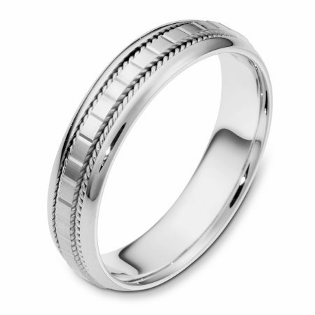 Item # 111641WE - 18 kt white gold, hand made comfort fit Wedding Band 5.0 mm wide. The center of the ring has a design with milgrain on each side. The whole ring is polished. Different finishes may be selected or specified.
