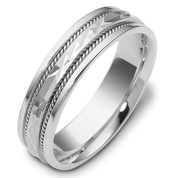 Item # 111661WE - 18 kt white gold, hand made comfort fit Wedding Band 6.0 mm wide. The center of the ring has a design with a handmade rope on each side. The whole ring is polished. Different finishes may be selected or specified.
