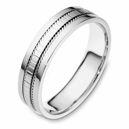 Item # 111671WE - 18 kt white gold, hand made, comfort fit Wedding Band 5.5 mm wide. The center of the ring has a design with a handmade rope on each side. The whole ring is polished. Different finishes may be selected or specified.