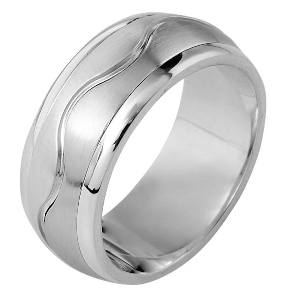 Item # 112061W - 14 kt white gold, hand made comfort fit Wedding Band 9.0 mm wide. The ring has a carved curvy line in the center. The center of the ring is matte and the outer edges are polished. Different finishes may be selected or specified.