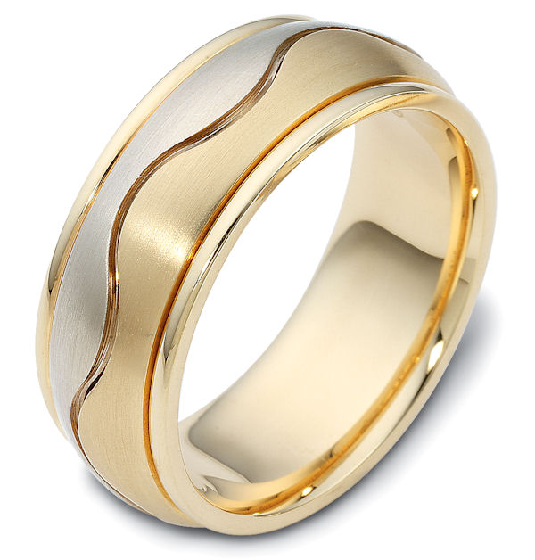 Item # 112071 - 14 kt two-tone hand made comfort fit Wedding Band 8.5 mm wide. The ring has a carved curvy line in the center. The center of the ring is matte and the outer edges are polished. Different finishes may be selected or specified.