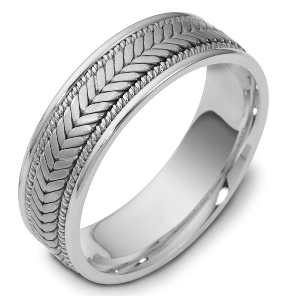Item # 114301PP - Platinum hand made comfort fit Wedding Band 7.0 mm wide. The ring has a handmade braid in the center with one hand crafted rope on each side of the the braid. The center is matte and the outer edges are polished. Different finishes may be selected or specified.