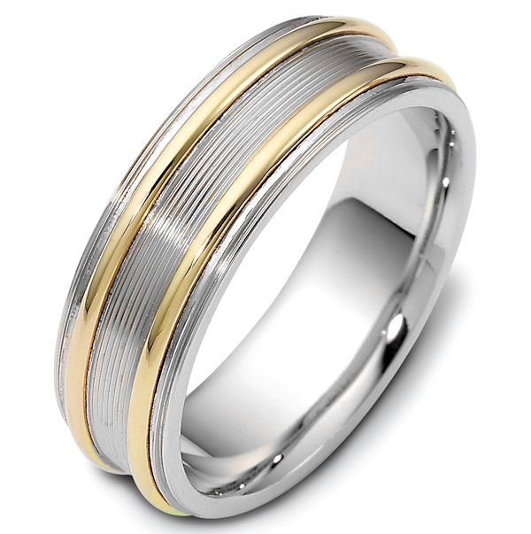 Item # 114861E - 18 kt two-tone hand made comfort fit Wedding Band 7.0 mm wide. There are carved lines in the center with a polished finish. The raised portion and outer edges are polished. Different finishes may be selected or specified.