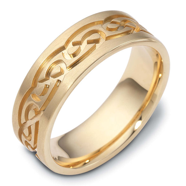 Item # 114881E - 18 K yellow gold, 7.0 mm wide, comfort fit, carved with Celtic wedding band. The ring has Celtic carved designs around the ring. It is matte finish. Different finishes may be selected or specified.