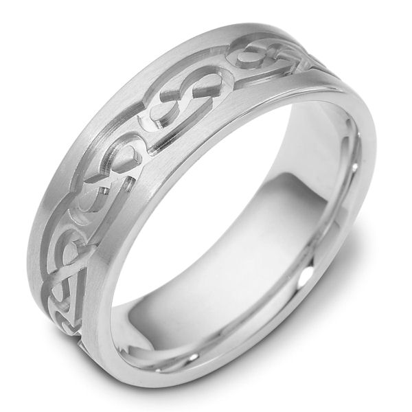 Item # 114881W - 14 K white gold, 7.0 mm wide, comfort fit, carved with Celtic wedding band. The ring has Celtic carved designs around the ring. It is matte finish. Different finishes may be selected or specified.