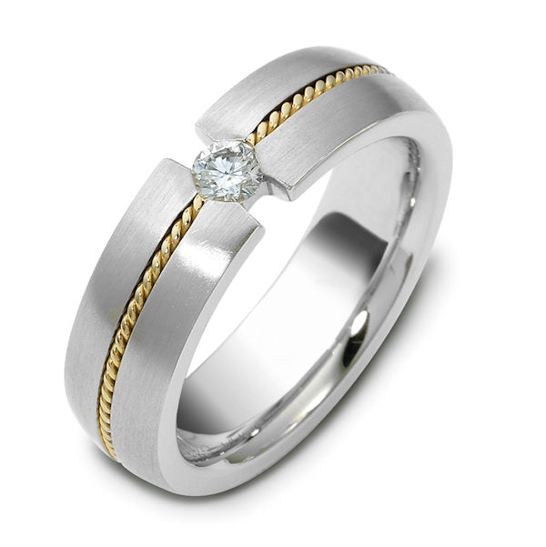 Item # 115621 - 14 K hand made two tone 6.0 mm wide, comfort fit, 0.12ct diamond VS2 in clarity G in color. There is one hand crafted rope in the center around the whole band. The band has a brush finish. Different finishes may be selected or specified.