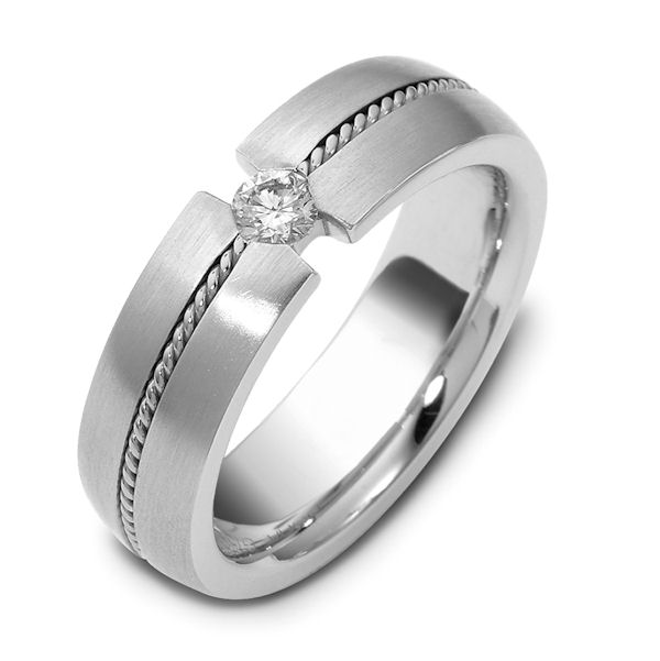 Item # 115621WE - 18 K hand made white gold, 6.0 mm wide, comfort fit, 0.12ct diamond, VS2 in clarity G in color. There is one hand crafted rope in the center around the whole band. The band has a brush finish. Different finishes may be selected or specified.