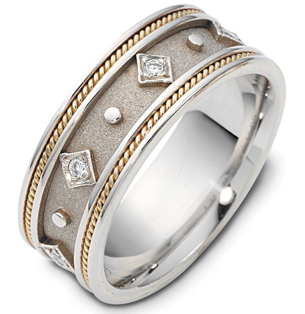 Item # 115891 - 14K two-tone, 8.5 mm wide, diamond ring. 0.15 ct diamond weight in size 6.0. The center of the ring is a coarse and heavy sandblast finish. There is one hand made rope on each side of the band. The outer edges are polished. Different finishes may be selected or specified.