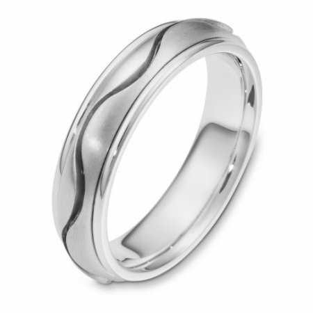 Item # 116961WE - 18 kt white gold, hand made comfort fit Wedding Band 6.0 mm wide. There is one carved curvy line in the center. It is a matte finish in the center and polished finish on the outer edges. Different finishes may be selected or specified.