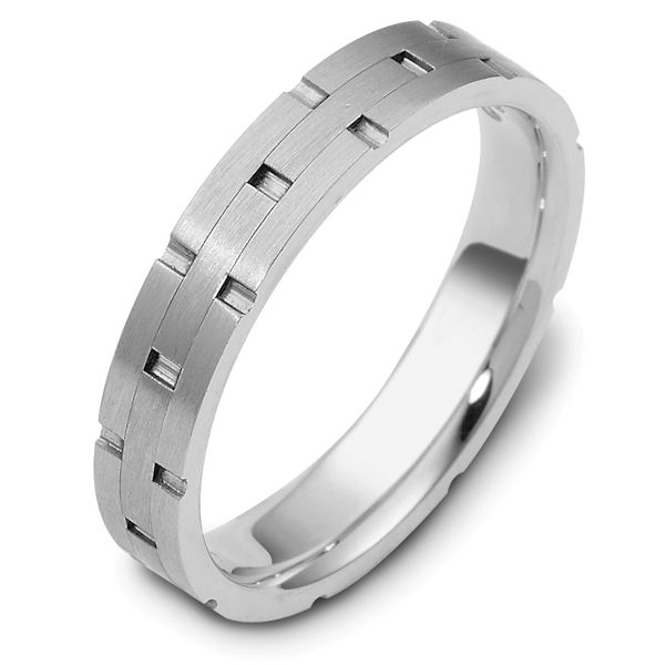 Item # 117241WE - 18 kt white gold, hand made comfort fit Wedding Band 4.0 mm wide. The ring has carved notches around the band and is a matte finish. Different finishes may be selected or specified.