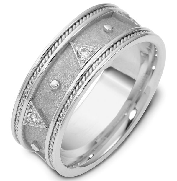 Item # 119011WE - 18K white gold, comfort fit, 8.5 mm wide, 0.15 ct diamond total weight wedding band. Diamonds are graded as VS1-2 in clarity G-H in color. There is one hand crafted rope on each side of the band. The center of the band is a coarse and heavy sandblast finish. The rest of the band is polished. Different finishes may be selected or specified.