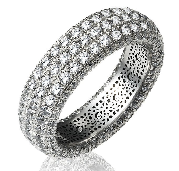 Item # 1374601PP - Platinum, diamond eternity ring. The ring pave set holds 266 diamonds in size 7 with diamond total weight of approximately 3.16ct. The diamonds are seven rows and each row contains 38 round brilliant diamonds. The diamonds are graded as VS in clarity G-H in color.
