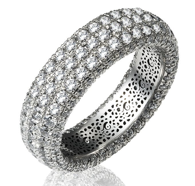 Item # 1374601WE - 18K white gold diamond eternity ring. The ring pave set holds 266 diamonds in size 7 with diamond total weight of approximately 3.16ct. The diamonds are seven rows and each row contains 38 round brilliant diamonds. The diamonds are graded as VS in clarity G-H in color.