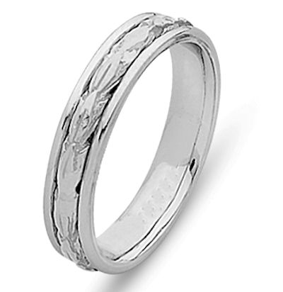 Item # 210505WE - 18 kt white gold hand crafted 5.0 mm wide, comfort fit Celtic wedding band. The leaves are hand carved in 18 kt white gold and have a matte finish. The outer edges are polished. Different finishes may be selected or specified.