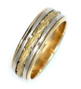 Item # 210688PE - Hand crafted, platinum and 18 kt yellow gold comfort fit band. The ring has 18 kt yellow gold leave carvings. It is 8.0 mm wide and comfort fit. The leaves are a matte finish and the rest of the ring is a polished finish. Different finishes may be selected or specified.