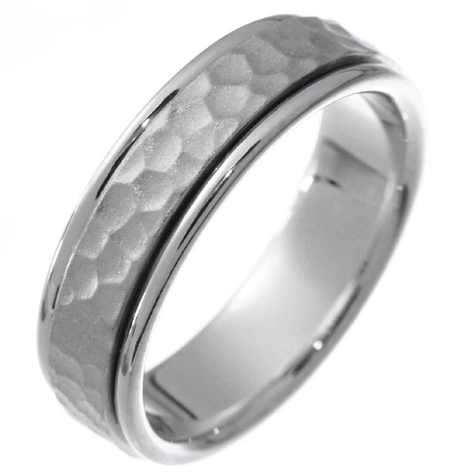 Item # 211121WE - 18Kt White gold hammered wedding band. The ring is about 6.5 mm wide and comfort fit. The hammered portion of the ring is a matte finish and the outer edges are polished. Different finishes may be selected or specified.